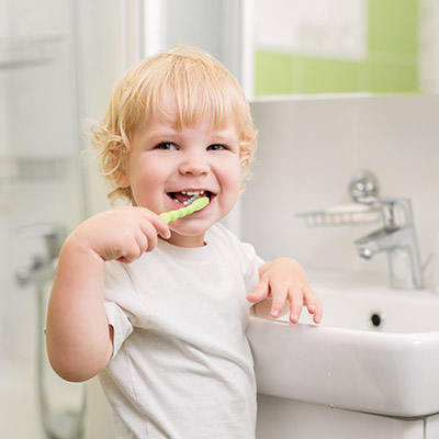 Baby brushing his teeth